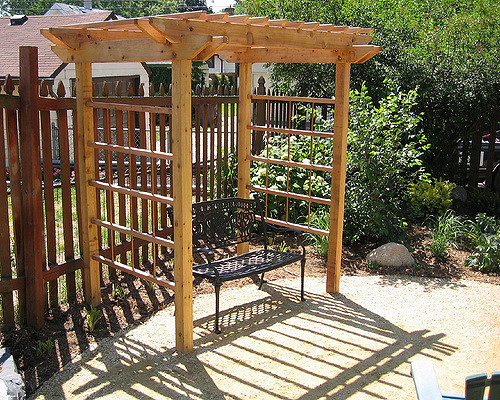 Pergolas and benches are examples of hardscapes